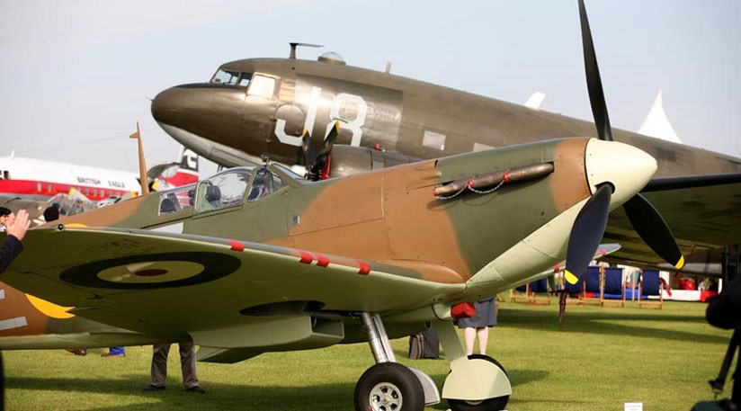 The iconic MK1 Spitfire in front of the DC3 Dakota in the Freddie March Spirit of Aviation concours