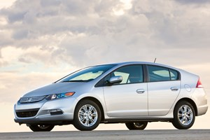 Production version of Honda Insight unveiled today. This is the US spec model