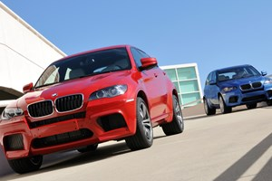The hardcore BMW SUVs: X5M (blue) and X6M (the red one)