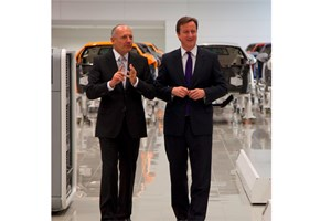 Ron Dennis (left) tells British prime minister David Cameron not to touch anything