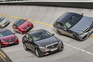 The facelifted Mercedes E63 AMG is seen on the banking to the right of this image