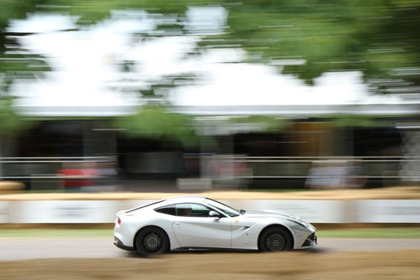 A Ferrari F12 blats up the hill on Thursday at the Moving Motor Show