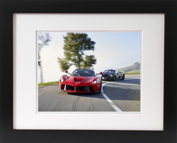 Win a framed print of CAR magazine's LaFerrari vs McLaren P1 cover story