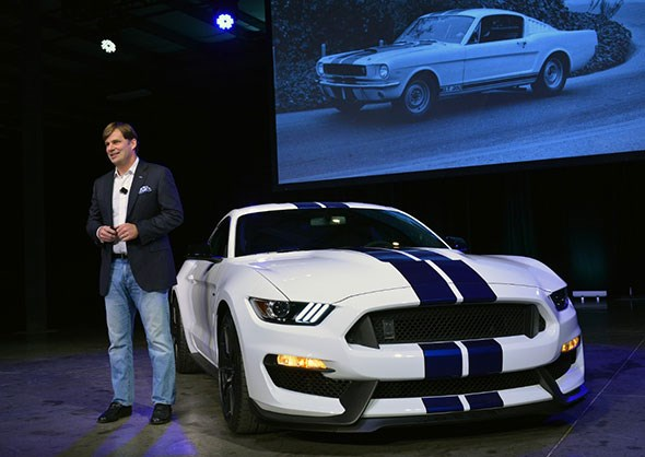 Ford's global sales and marketing vice president Jim Farley with the Ford Shelby GT350 Mustang