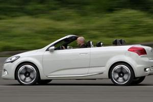 kia 39 s drives kia exceed cabrio concept. Black Bedroom Furniture Sets. Home Design Ideas